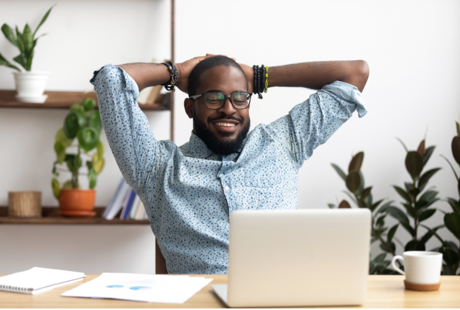 refreshed black man sitting at computer
